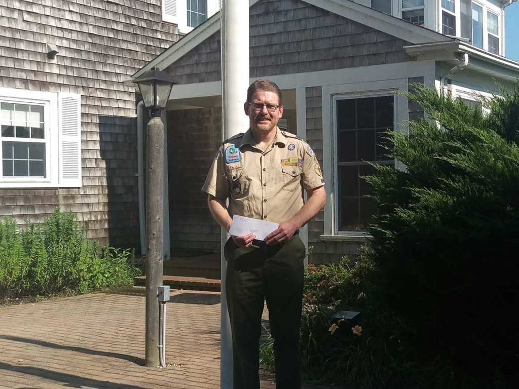 Representative of Boy Scouts of Sandwich holding check